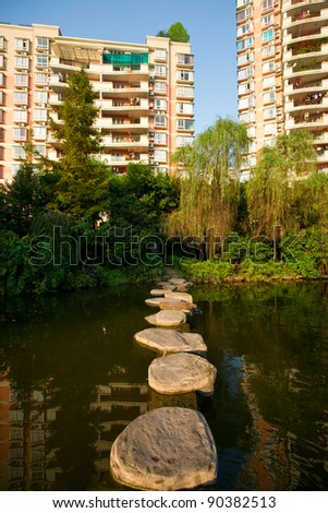 Pond with new house - stock photo