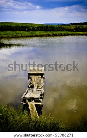 pond with quay for fishing - stock photo