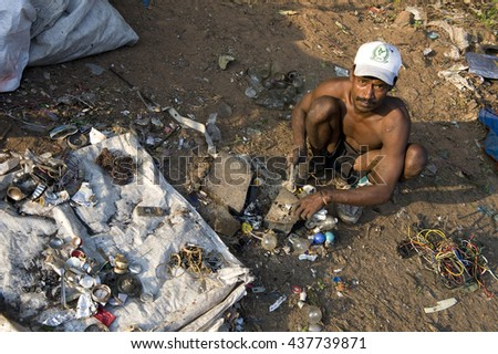 PONDICHERRY, INDIA - January 11, 2015: The Dump. People searching recycling materials to sell