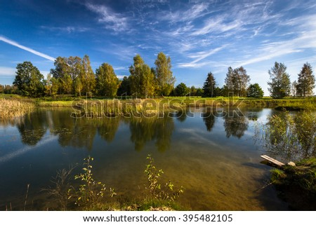 Ponds in autumn with cloudy sky