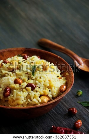 Pongal / rice cooked with lentils and seasoned with nuts curry leaves and chilli