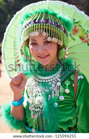 PONGYANG, CHIANGMAI/THAILAND - JANUARY 15: Unidentified traditionally dressed Hmong hill tribe woman in Hmong new year festival on January 15, 2013 in Chiangmai, Thailand. - stock photo