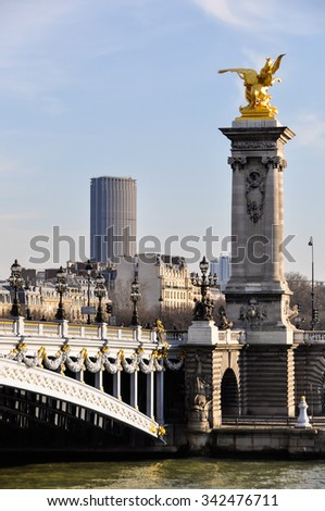 Pont Alexandre III and Montparnasse Tower in the background in Paris, France - stock photo