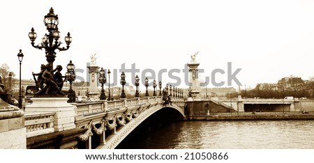 Pont Alexandre III - Bridge in Paris, France.  Movement on cars driving - Gloomy winters day. Copy space, sepia tone - stock photo