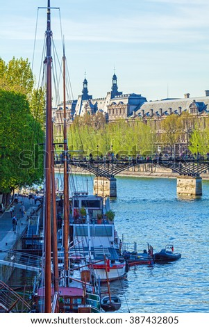 Pont des Arts, pedestrian bridge in Paris which crosses the River Seine - stock photo