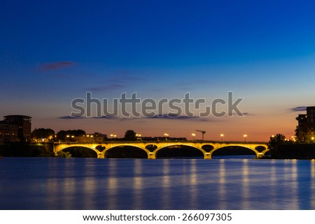 Pont Des Catalans in Toulouse lit up at night - stock photo