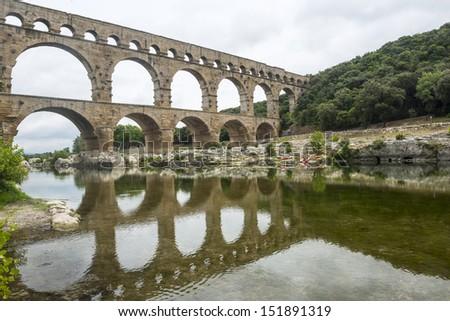 Pont du Gard (Gard, Languedoc-Roussillon, France), the famous bridge, Unesco World Heritage Site - stock photo