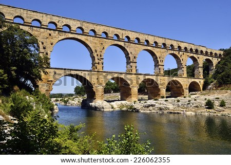 Pont du Gard is an old Roman aqueduct near Nimes, France - stock photo