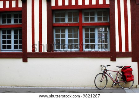 Pont l'Évêque - Normandy (France) - Bicycle and red white house - stock photo
