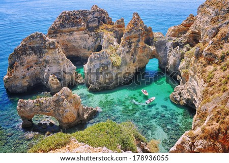 Ponta da Piedade - two boats with tourists between famous rocks in the ocean. Number one attraction in Lagos, Algrave, Portugal - stock photo