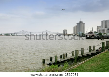 Pontchartrain Bridge over the Mississippi river in New Orleans on a cloudy day - stock photo