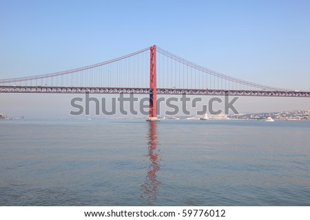 Ponte 25 de Abril - Suspension bridge over the Tagus river in Lisbon, Portugal - stock photo