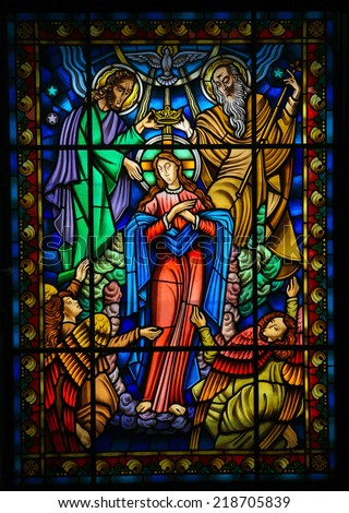 PONTE DE LIMA, PORTUGAL - AUGUST 3, 2014:  Stained glass window depicting Mother Mary and the Holy Trinity in Ponte de Lima, a town in the Northern Minho region in Portugal. - stock photo