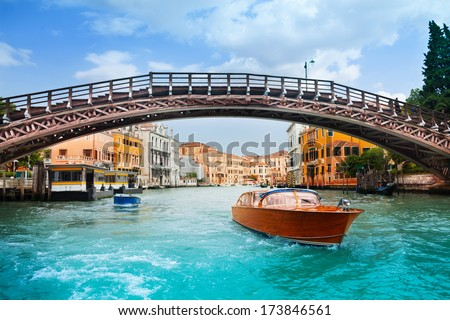 Ponte dell'Accademia in Venice and motorboats on grand canal in Venice - stock photo