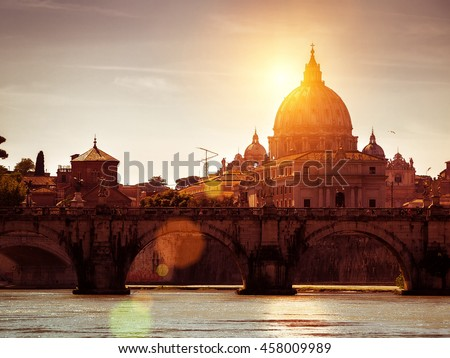 Ponte Sant`Angelo (Bridge of Holy Angel) and Basilica San Pietro (Saint Peter's cathedral) at sunset in Rome, Italy.