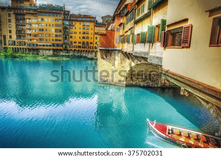 Ponte Vecchio and Arno river in Florence, Italy - stock photo