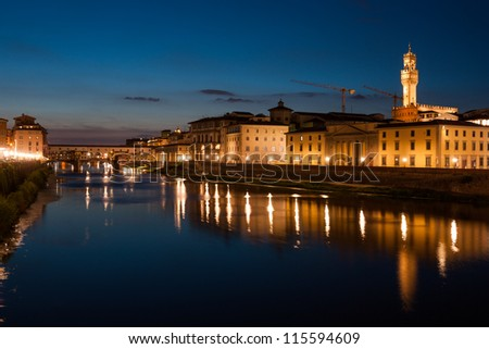 Ponte Vecchio and Palazzo Vecchio after sunset with reflections on Arno river