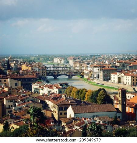 Ponte Vecchio, Arno River - instagram effect. Famous Florence bridge - retro photo filter. City view and Ponte Vecchio bridge - vintage colors. Florence, Tuscany, Italy. - stock photo