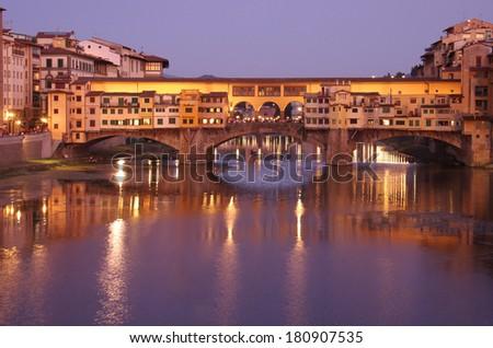 Ponte Vecchio bridge across Arno River in the evening, Florence, Italy - stock photo