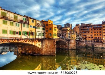 Ponte Vecchio bridge in Florence, Italy. Arno River. Tuscany - stock photo