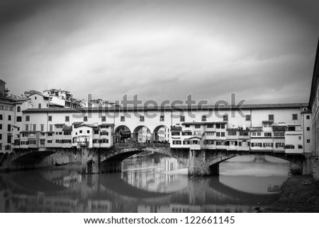Ponte Vecchio, Florence with reflections in the Arno River - stock photo