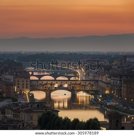 Ponte Vecchio in Florence Italy during sunset - stock photo