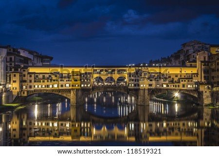 Ponte Vecchio in Florence, Italy with water  reflection at Night - stock photo
