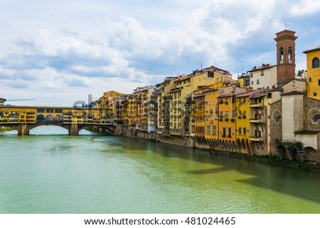 Ponte vecchio in the italian city florence during a cloudy day.