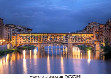 Ponte Vecchio (Old Bridge) in Florence/Firenze, Italy at night - stock photo