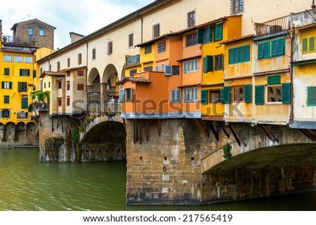 Ponte Vecchio over Arno river - famous old bridge in Florence, Italy - stock photo
