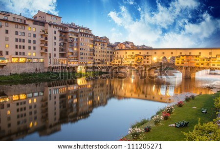 Ponte Vecchio view from Lungarni with Arno river, Spring Sunset in Florence - Italy - stock photo