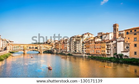 Ponte Vecchio with river Arno at sunset, Florence, Italy - stock photo