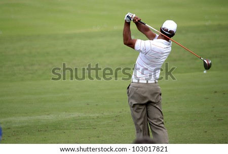 PONTE VEDRA, FL -   MAY 08 : Tiger Woods  (USA) practices at The Players championship, PGA Tour, on practice day May 08, 2012, at The TPC Sawgrass, Ponte Vedra, Florida, USA. - stock photo