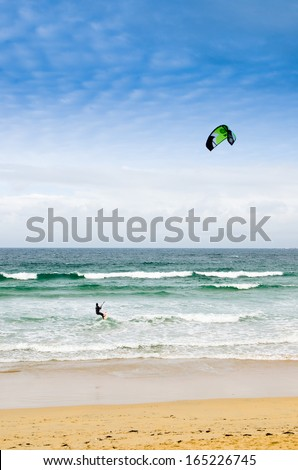 PONTEVEDRA, OCTOBER 27: Athletes practice windsurfers on the waves on the beach A Lanzada in Galicia (Spain) during the fall, October 27, 2013.