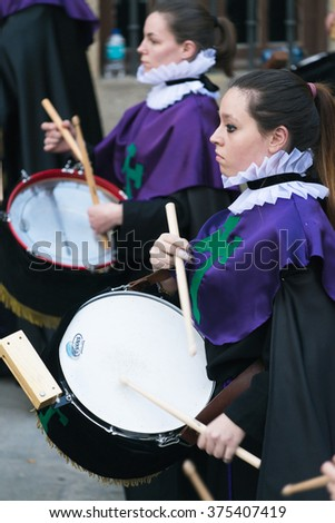 PONTEVEDRA, SPAIN - APRIL 2, 2015: A band of wind and percussion instruments of a religious brotherhood, during a procession procession in celebration of Easter in the historic center of the city. - stock photo