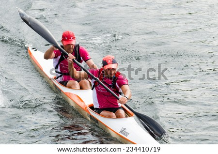 PONTEVEDRA, SPAIN - AUGUST 3, 2014: Extreme athletes participating in the Spain Copa Canoe Marathon in Lerez River, to qualify for the World Championship, , Sporting event free access to public - stock photo