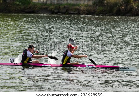 PONTEVEDRA, SPAIN - AUGUST 3, 2014: Extreme athletes participating in the Spain Copa Canoe Marathon in Lerez River, to qualify for the World Championship. - stock photo
