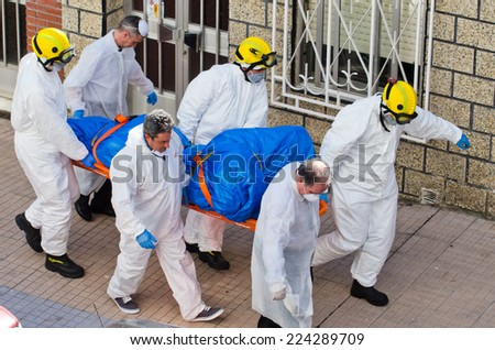 PONTEVEDRA, SPAIN - JUNE 17, 2014: A group of firefighters during an operation to rescue the corpse of a migrant found dead of natural causes at his home. - stock photo