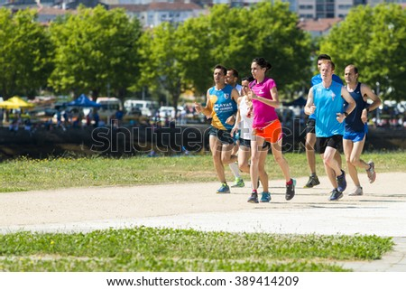PONTEVEDRA, SPAIN - JUNE 7, 2015: A group of people practice running in one of the city parks. - stock photo