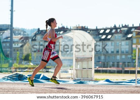 PONTEVEDRA, SPAIN - JUNE 21, 2015: Detail of the participants in the Spain Championship Elite Sprint Triathlon, held in the city. - stock photo