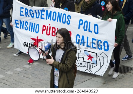 PONTEVEDRA, SPAIN - MARCH 24, 2015: Demonstration of university, during the strike against the education law education minister of the Conservative government. - stock photo