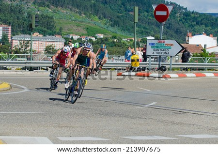 PONTEVEDRA, SPAIN - MAY 31, 2014: Detail of the participants in the Duathlon World Championships in the Junior Men's category, on the streets of the city.