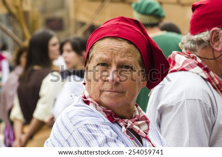 PONTEVEDRA, SPAIN - SEPTEMBER 6, 2014: A woman in vintage dress in medieval festival held each year in the historical district of the city.