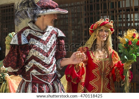 "PONTEVEDRA, SPAIN - SEPTEMBER 5, 2015: People dressed in medieval clothes during the celebration of the annual festival ""Feira Franca"" which is held every year in the city."