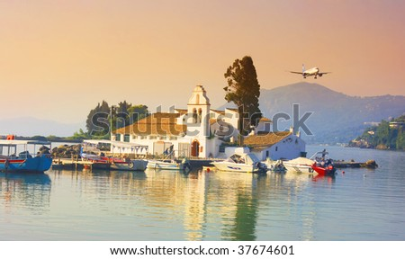 Pontikonisi area at Corfu island with airplane flying, Greece - stock photo