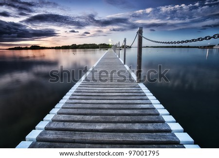 pontoon jetty across the water in yamba nsw - stock photo