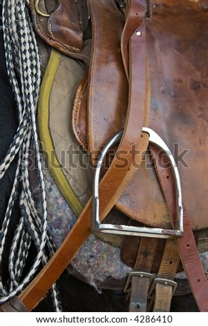 Pony saddle, horse waiting for the rider at the ranch - stock photo