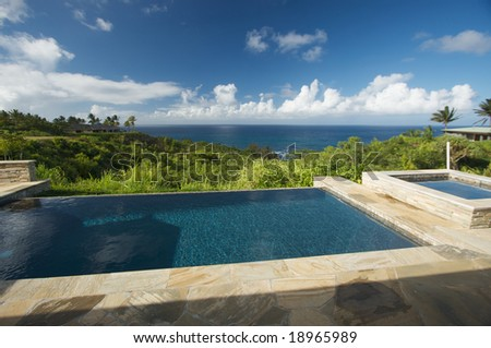 Pool and Hot Tub Overlooking the Ocean - stock photo
