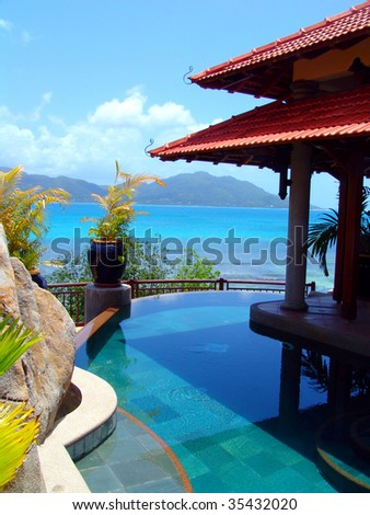 pool and tropical beach - travel background - stock photo