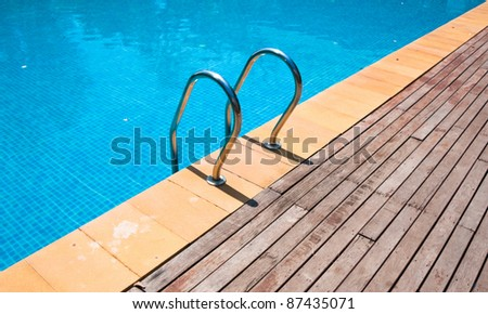 Pool and wooden floor - stock photo